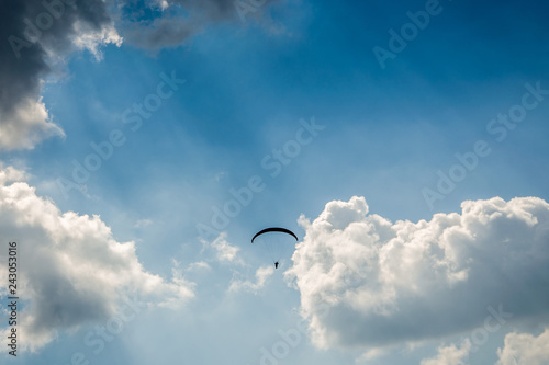 Paragliding in the sky,Paraglider taking off in front of spectacular mountain scenery