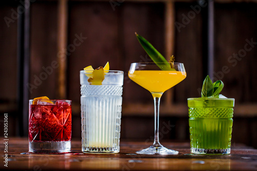 Slika na platnu Image of colorfull coctails in the bar, mixology concept