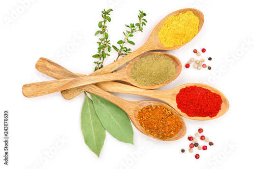 Fotografía  mix of spices in wooden spoon isolated on a white background