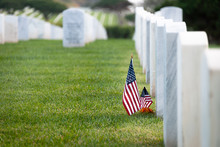 American Flags At White Marble Grave