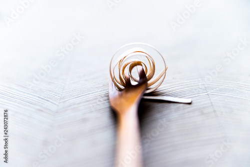 Fototapeta Wooden fork and fake spaghetti made by woodchips