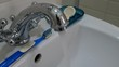 Clean water flows from the chromed metal tap. Running water. Representing water wastage. Plumbing equipment for home.