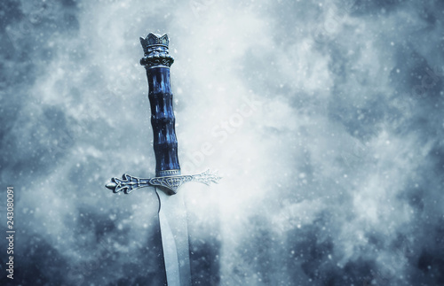 Photo mysterious and magical photo of silver sword over gothic snowy black background