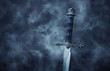 canvas print picture - mysterious and magical photo of silver sword over gothic black background with smoke. Medieval period concept