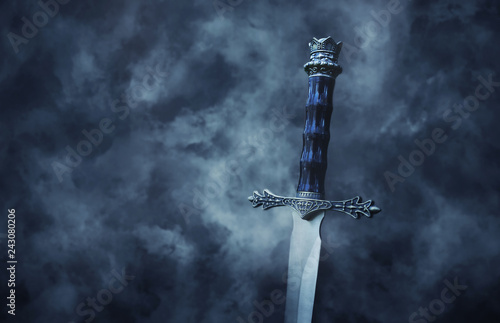 Obraz na płótnie mysterious and magical photo of silver sword over gothic black background with smoke