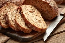 Fresh Baked Sliced Bread On Wooden Background