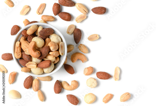 obraz dibond salted cocktail nuts in small cup isolated