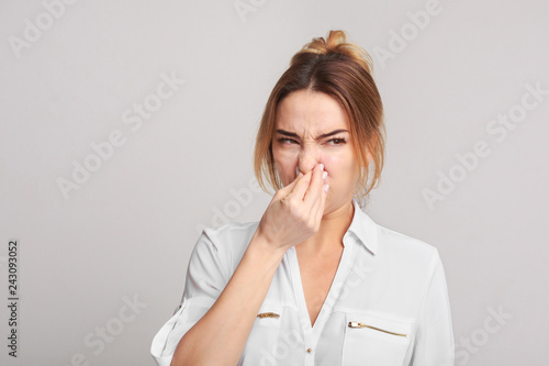 Fotografie, Tablou  Woman closing nose because of bad smell
