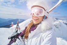 Young Woman Skier At Winter Ski Resort In Mountains,