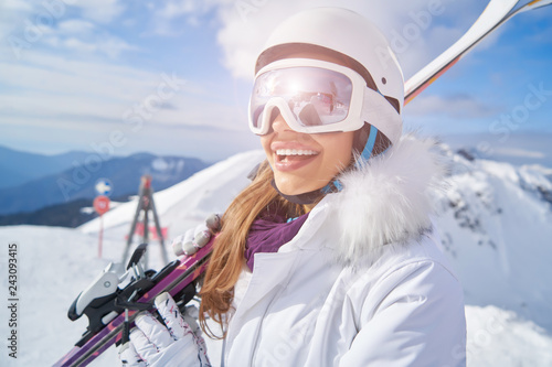 Fotografie, Obraz  Young woman skier at winter ski resort in mountains,