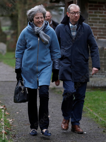 80060c0aefa3 Britain s Prime Minister Theresa May and her husband Philip leave church
