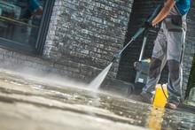 Men Washing Driveway