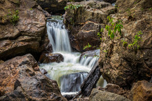 Small Waterfall Between The Ro...