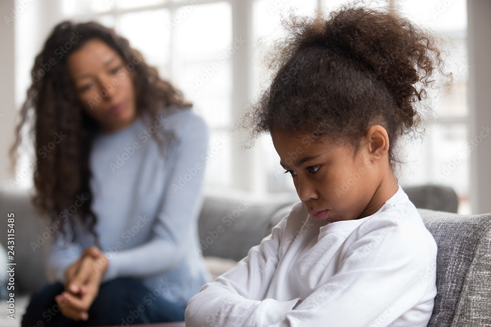 Fototapety, obrazy: Mom or psychologist talking counseling upset offended african american child girl feels sad insulted, sulky frustrated black mixed race kid daughter having psychological trauma depression problem
