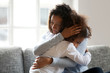 canvas print picture - Loving single black mother hugging african daughter caressing cuddling, caring mom embracing supporting girl, mum and kid sincere warm relationships, foster care, child custody, adoption concept