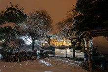 Beautiful Night Winter In Garden With Snow-covered Trees And Benches