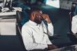 Dispatcher man having rest on operator backchair