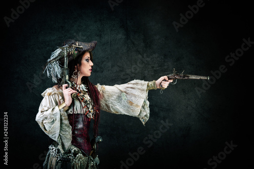 Sexy pirate in profile holding a musket in his hands Canvas Print