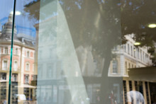 Empty Shop Window For Logo, Brand Mockup. City Street And Buildings In Window Reflection.
