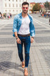 sexy casual man walking on city streets and smiling