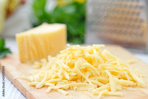 Fototapeta Grated cheese on the table obraz