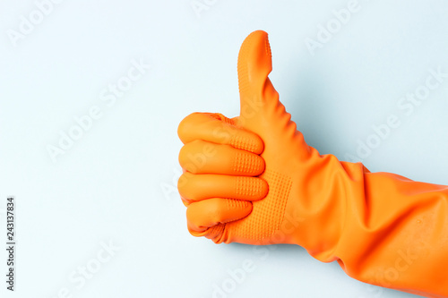 Fotografia, Obraz  Female hand in orange rubber gloves with raised up his thumb on a white backgrou