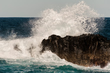 High Wave Of Stormy Sea Beating The Rock