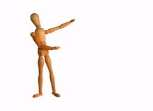 Wooden Artists Manikin Or Mannequin  Pointing At Copy Space With White Background