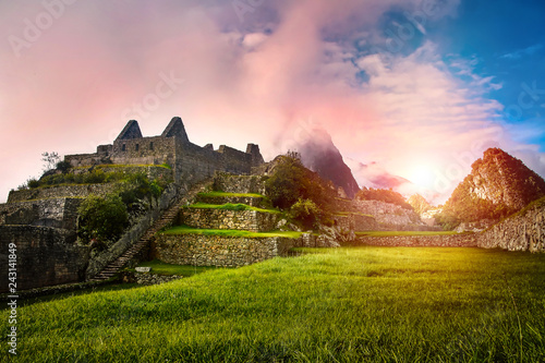 Ingelijste posters Rudnes Scenic landscape of the stone ruins Machu Picchu at sunrise. Huayna Picchu mountain in the clouds in the background