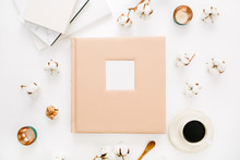 Composition With Wedding Or Family Photo Album, Cotton Buds, Coffee Cup On White Background. Flat Lay, Top View Still Life Concept.
