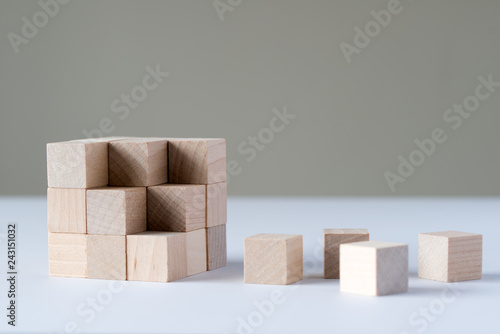 Photo  Wood cubes to complete a bigger square block