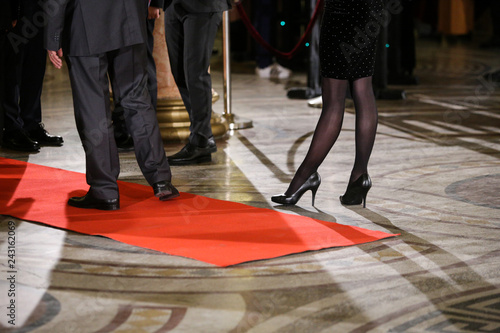 Fotografie, Obraz  Details with the high heels shoes and feet of a young lady