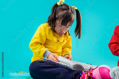Valokuva  Dark-haired young girl with mental disorder pushing out tongue