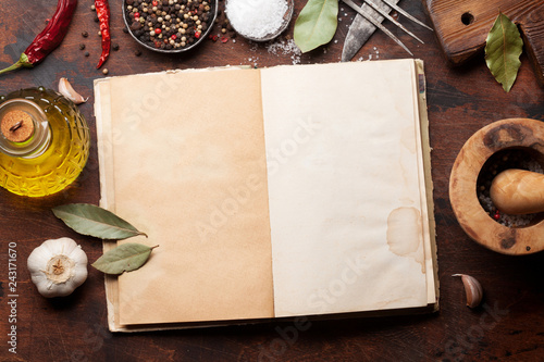 Set of various spices and herbs and cookbook