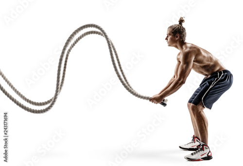 Fotografie, Obraz  Muscular man working out with heavy ropes