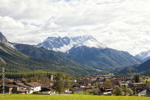 Wall Murals Nepal View of the village of Ehrwald (Austria) and its beautiful surrounding mountains (Zugspitze Arena) and green alp meadows. Shot in afternoon sunlight.
