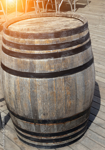 old wooden barrel sunset