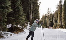 Cross Country Skier Enjoying Beautiful Nature. Out In The Woods