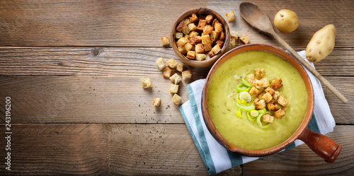 Leek and potato soup with croutons. Top view, space for text Wallpaper Mural