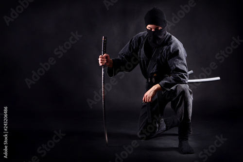 Ninja samurai crouched on one leg  and propped on a sword Canvas Print