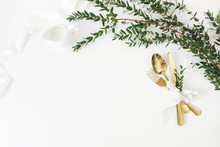 Festive Wedding, Birthday Table Setting With Golden Cutlery, Eucalyptus Parvifolia, Silk Ribbon And Milk Pitcher On White Table Background. Rustic Restaurant Menu Concept. Flat Lay, Top View. Empty
