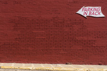 "Red Painted Brick Wall With ""P"