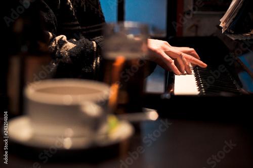 man playing piano - 243214804
