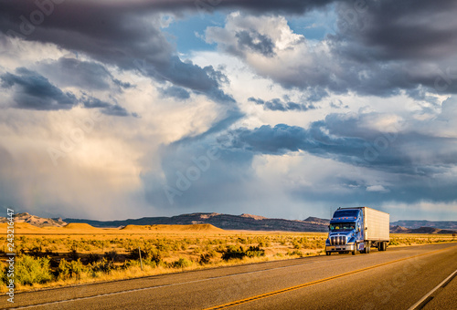Semi trailer truck on highway at sunset