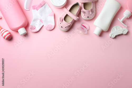 Fotografia  Flat lay composition with baby accessories on color background