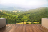Fototapeta Fototapety na ścianę - Balcony view of  mountains. Landscape. Sunny Day. Terrace with a beautiful view.