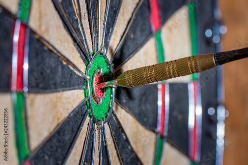Fotografie, Obraz  Macro dart hitting the bulls eye