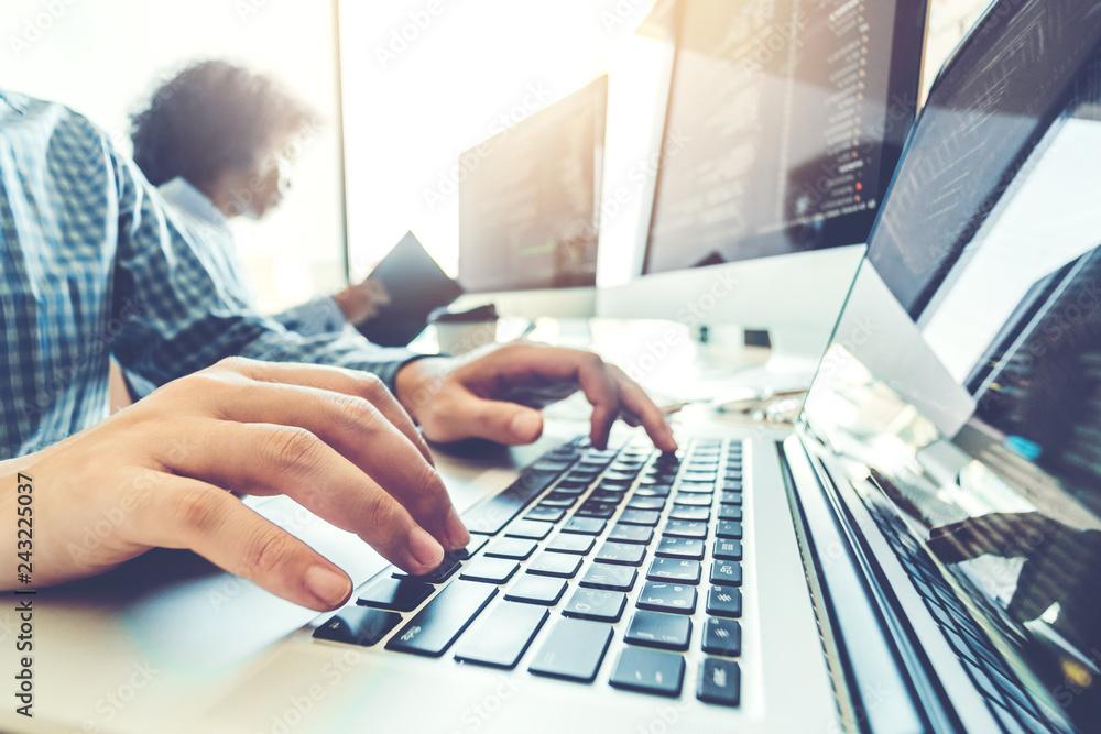 Fototapeta Developing programmer Team Development Website design and coding technologies working in software company office