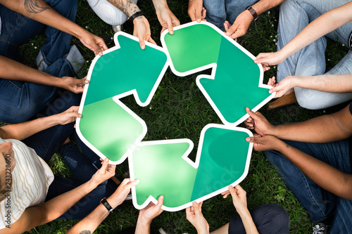 Fototapeta  Group of people with a recycling board