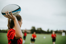 Female Rugby Player Holding A Ball